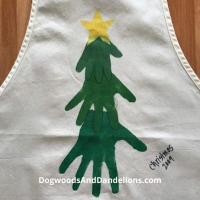 Hand prints on an apron make an easy homemade Christmas gift.