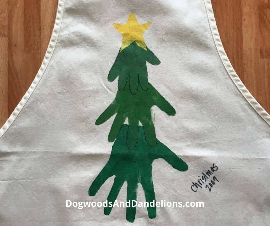 Hand prints on an apron make an easy homemade Christmas gift.